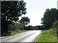 TG2824 : Approaching junction of Scottow Road with Norwich Road (B1150) by Evelyn Simak