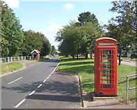 TM0848 : Somersham village street and telephone box by Andrew Hill