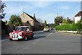 TF7319 : Car Rally on the B1145 at Gayton by Robert Walden
