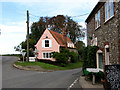 TF9839 : Pink cottage on junction of Hindringham Road with Warham Road by Evelyn Simak