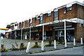 SP3383 : Parade of Shops, Holbrook Lane by Niki Walton