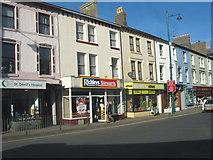 SH5638 : Small shops on Porthmadog's High Street by Eric Jones