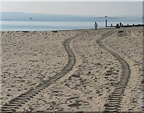 SZ1090 : Bournemouth: tractor tracks in the sand by Chris Downer