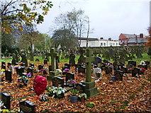 SJ5798 : St Oswald & St Edmund Arrowsmith RC Church, Ashton-in-Makerfield, Graveyard by Alexander P Kapp