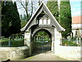 NZ1685 : Snowdrops by the lych gate at Mitford Church by sylvia duckworth