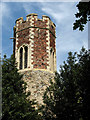 TG2124 : St Peter's Church - a close view of the tower by Evelyn Simak