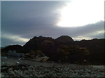 NS4074 : Dumbarton Rock from behind Morrison's by Stephen Sweeney
