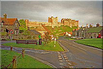 NU1834 : Bamburgh showing main street with castle in background by Christine Matthews