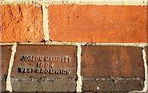 SW6439 : Stamped brick, Camborne Railway station by Tom Jolliffe
