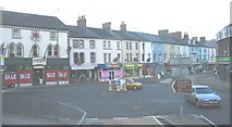 SH5638 : Shops in the western section of Porthmadog's High Street by Eric Jones