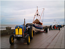 NZ6025 : Fishing boats and their tractors on Redcar seafront by Steve  Fareham