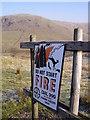NY5503 : Sign, Ashstead Fell by Michael Graham