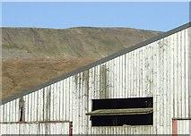 SD7579 : Whernside above a Barn at Gunnerfleet Farm by Roger Nunn