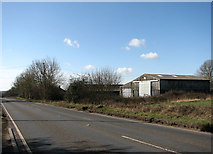 TF9203 : Agricultural sheds beside the A1075 by Evelyn Simak
