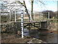 NY9965 : Footbridge over Cor Burn at the ford by Mike Quinn