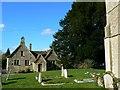 SU0995 : Old school house and St John the Baptist churchyard, Latton by Brian Robert Marshall
