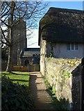 SX7087 : Chagford: church and cottage by Derek Harper