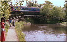 TQ0562 : Footbridge (roving bridge) and railway bridge over the Wey Navigation by Dr Neil Clifton