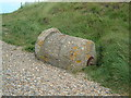 TG0844 : WW2 Spigot mortar Base on top of shingle bank by John Beniston