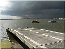 SZ1891 : Mudeford: lifeboat slipway and threatening sky by Chris Downer