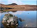 NH0463 : Rock in Loch by Stephen Middlemiss