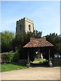 TG0600 : Lychgate and tower of St Botholph's church by Evelyn Simak