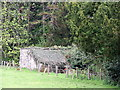 NU1228 : Old estate dog kennels at Twizell Mill by Alfie Tait