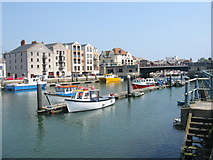 SY6778 : Weymouth Harbour, Town Bridge and harbourside development by Maurice D Budden