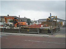 SZ6599 : Diggers on corner of Fernhurst Road and Goldsmith Avenue by Basher Eyre