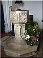 TF9932 : St Mary's church - baptismal font by Evelyn Simak