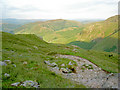 NY2605 : Looking ahead down the path. Lingmoor Fell is still in sunlight. by Ian Greig