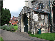 TG1022 : St Michael's church - south porch by Evelyn Simak