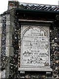 TG1022 : St Michael's church - porch detail by Evelyn Simak