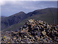 NY1410 : Summit cairn, Haycock by Tom Richardson