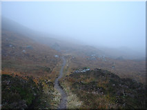 NN4974 : Scotch Mist over the path in Bealach Dubh beneath Sgòr Iutharn by John Lucas