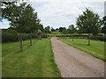 SO7629 : Footpath down a driveway by Pauline E