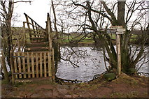 NY5027 : Footbridge over River Eamont with sign by Paul Collins