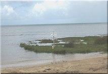 SH5580 : Marooned no shooting and footpath signs on Llanddona beach by Eric Jones
