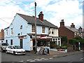TG0433 : Butcher's shop on Briston Road (B1354) by Evelyn Simak