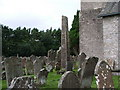 NY5674 : Bewcastle: the churchyard at St Cuthbert's, with the 7thC Cross by Keith Salvesen